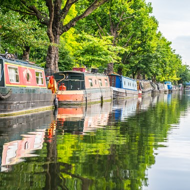 row of narrowboats on canal