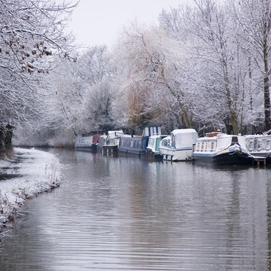 narrowboats riverboats on canal in winter
