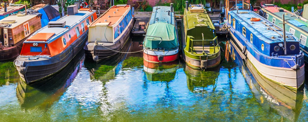 Narrowboats moored alongside each other